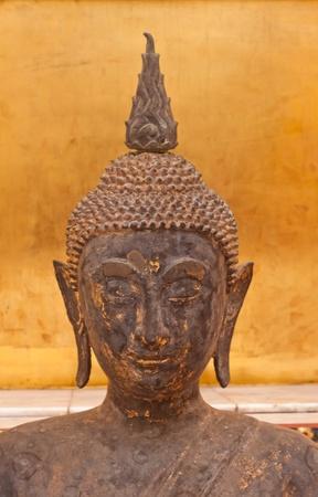 Face of golden Buddha image photo