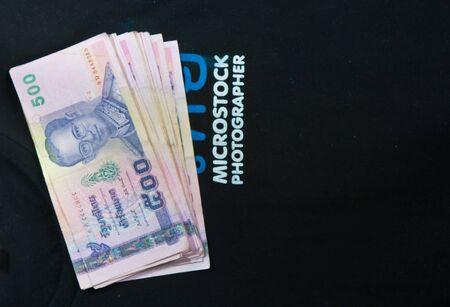 500 baht Thailand money On a black shirt. photo