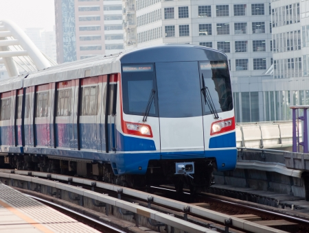 Sky train in Bangkok with building construction.  Editorial