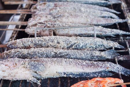 Grilled fish with salt on the stove  In the Thai market  photo
