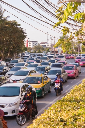 standstill: BANGKOK - DEC 23: Daily traffic jam in the afternoon on dec 23, 2012 in Bangkok, Thailand. Traffic jams remains constant problem in Bangkok despite rapid development of public transportation system.