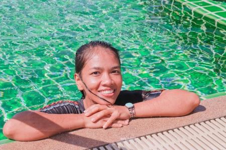 Thai Girl Portrait  In Swimming pool Stock Photo
