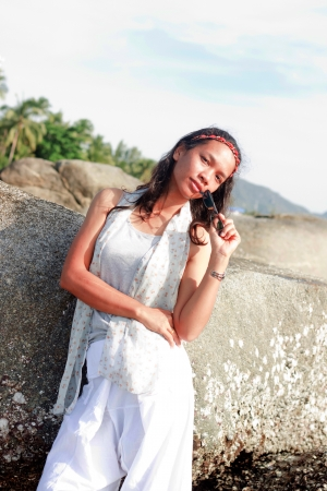 thai girl portrait Young woman on the beach  photo