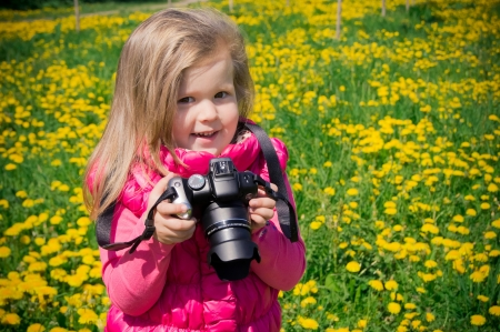 Little photographer girl photo