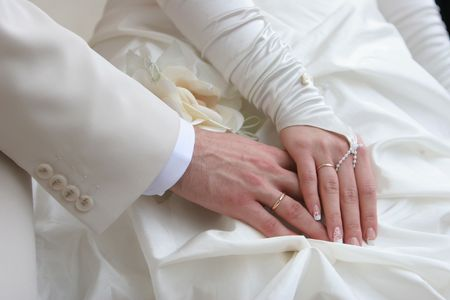 Bride and groom hands with golden rings Stock Photo - 3810944