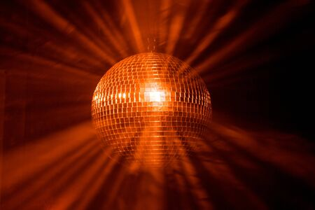 Disco ball with rays in haze photo
