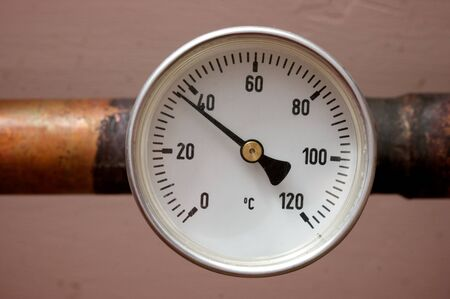 watertap: Heating and water thermometer in the cellar of a house Stock Photo