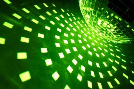 Disco ball with green illumination photo