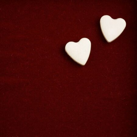 pair of valentine hearts on red photo