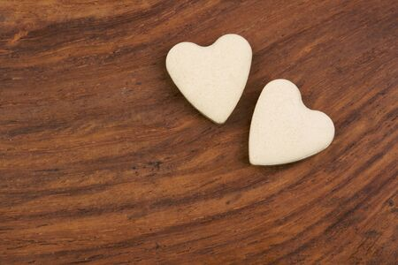 pair of valentine hearts on wooden surface photo