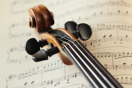violins: scroll on music sheet