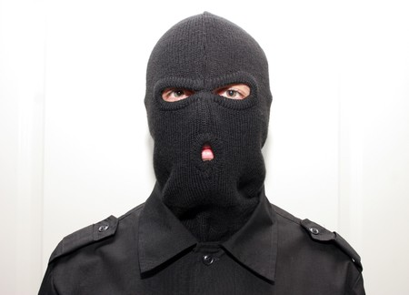 shoplifter: an burglar wearing a ski mask (balaclava)