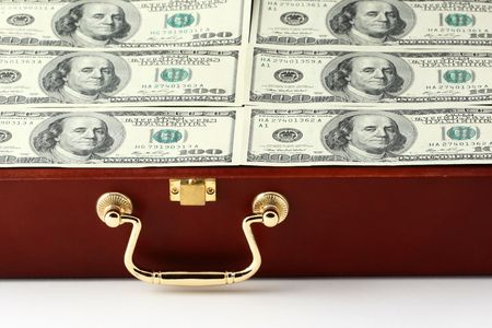 corporate greed: case with money closeup