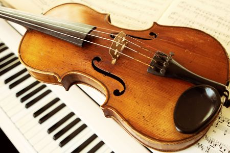 violins: violin and piano keys Stock Photo
