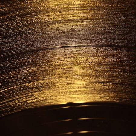 closeup of golden vinyl record photo