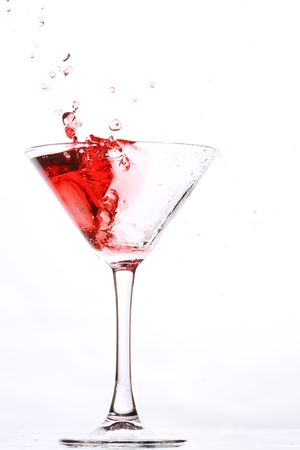 spilling: red cocktail on white Stock Photo