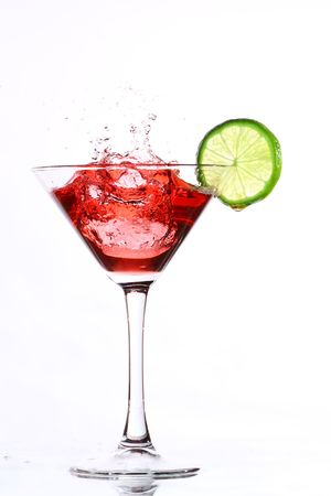 stirred: red cocktail with lime on white Stock Photo