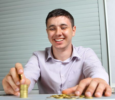 lend: businessman putting the coins in columns Stock Photo