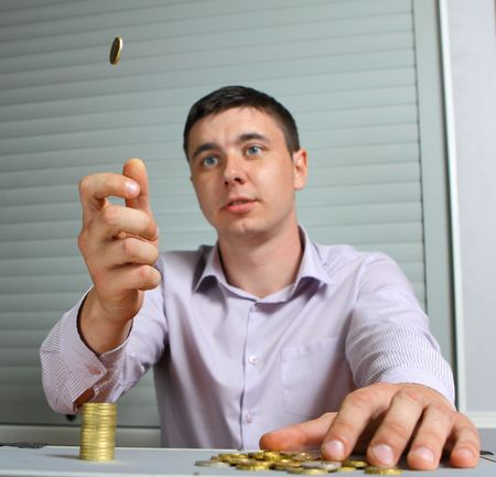 man throwing up a coin photo