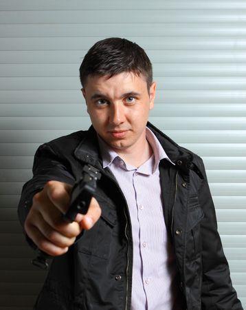 pointed arm: man aiming the gun Stock Photo