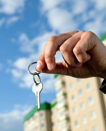 hand holding keys, house in the background Stock Photo - 5006267