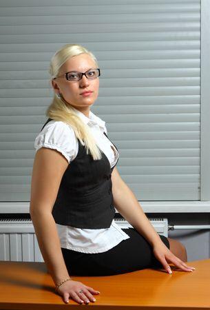 sexy secretary: sexy secretary sitting on the table