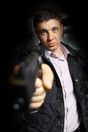 pointed arm: angry man aiming the gun