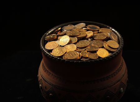 end of rainbow: pot of golden coins