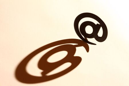 electronically: email sign with real shadow Stock Photo