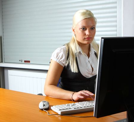 working place: businesswoman at her working place Stock Photo