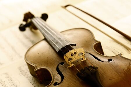 concerto: antique violin with fiddlestick Stock Photo