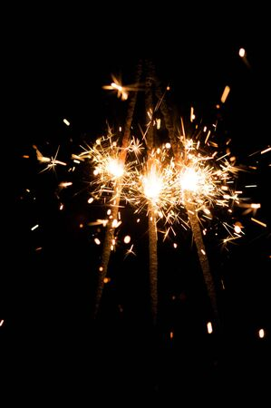 yellow sparkler with fire particles Stock Photo - 5345800