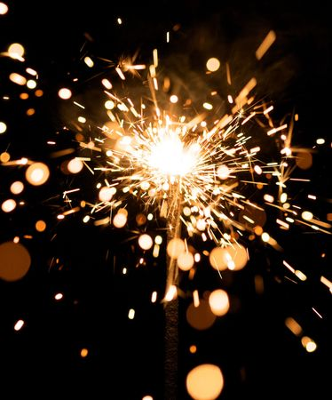 yellow sparkler with fire particles Stock Photo - 5544640