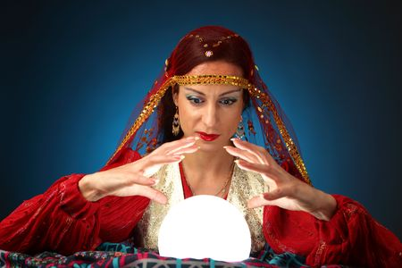 fortune-teller with shining crystal ball photo
