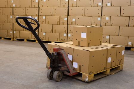 boxes on hand pallet truck photo