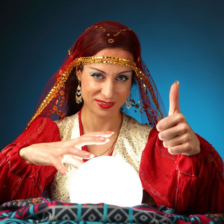 gypsy woman: fortune-teller showing everything will be all right
