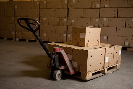boxes on hand pallet truck Stock Photo - 5698942