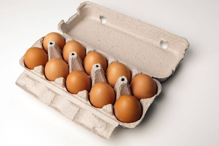 chicken eggs in the container on white photo