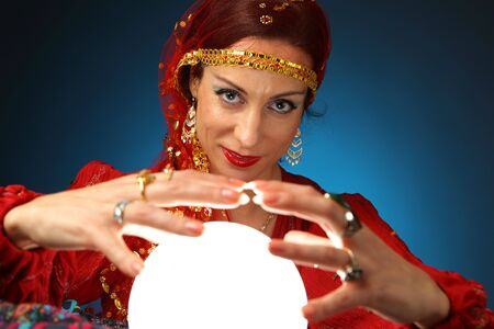 fortune: fortune-teller with a shining crystal ball