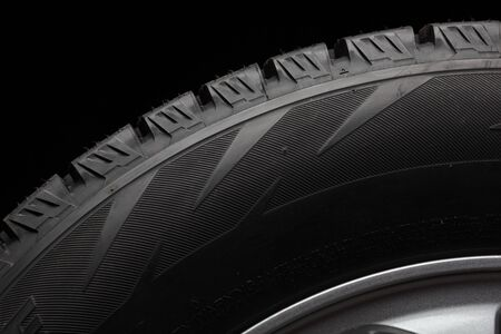vulcanization: part of winter tyres isolated on black