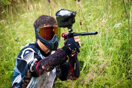 shooter: paintball shooter aiming the gun