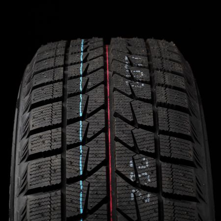 part of winter tyres on black Stock Photo - 5859707
