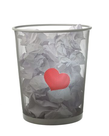unrequited love: unrequited love concept - red heart in the trash can