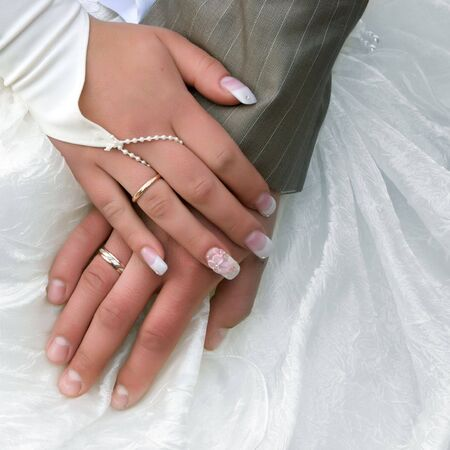 hands of married couple with golden rings Stock Photo - 5965520
