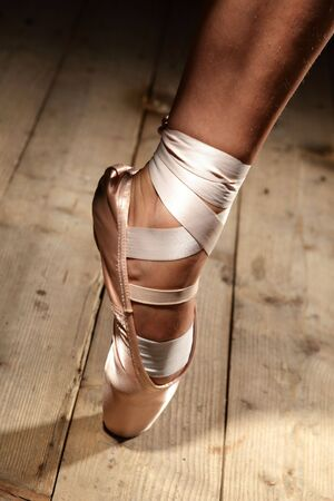 pointes: foot of ballet dancer on the floor Stock Photo