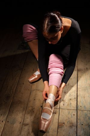ballet dancer tie up her pointes Stock Photo - 6068766