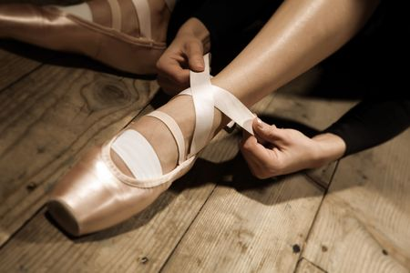 ballet shoes: ballet dancer tie up her pointes