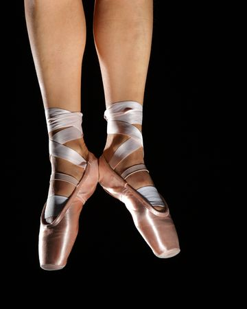 foots with pointes of ballet dancer isolated on black Stock Photo - 6069011