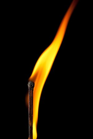 igniting: igniting match with tongue of flame on black