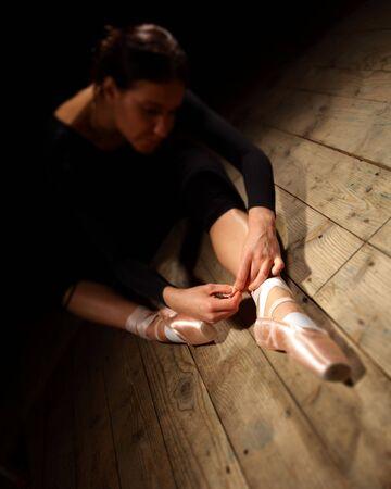 ballet dancer tie up her pointes Stock Photo - 6068760